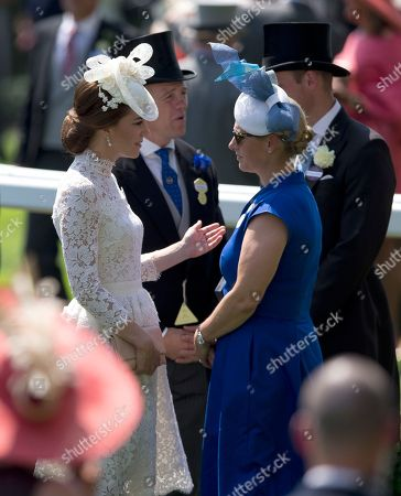 Stock Photo of Kate, Duchess of Cambridge, left, speaks to Zara Philips in the parade ring on the first day of the Royal Ascot horse race meeting in Ascot, England