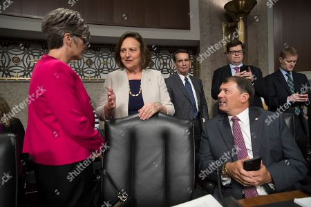 Joni Ernst, Deb Fischer, Mike Rounds From left, Senator Joni Ernst, R-Iowa, Senator Deb Fischer, R-Neb., and Senator Mike Rounds, R-S.D., confer before the start of a Senate Armed Services Committee hearing at the Capitol in Washington
