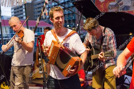 Brendan Cox (centre), husband of murdered MP, Jo Cox plays in his folk band, the Diddly Dee at The Great Get Together at Tower Bridge Moorings in London
