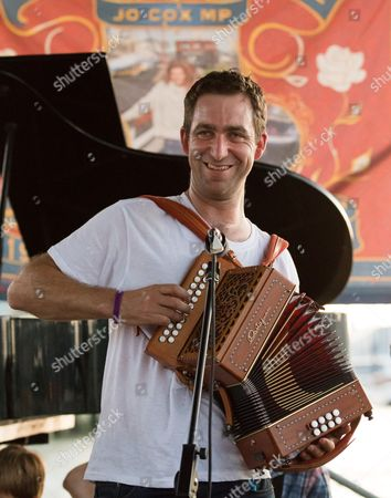 Brendan Cox, husband of murdered MP, Jo Cox plays in his folk band, the Diddly Dee at The Great Get Together at Tower Bridge Moorings in London