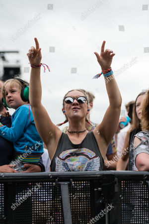 Festival goers dance during the first performance of the day at the Pyramid Stage by Hacienda Classical - Graeme Park, Mike Pickering & Manchester Camerata Orchestra