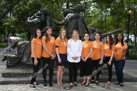 """CARE's COO Heather Higginbottom and team stand by """"The Immigrants"""" statue in Battery Park on in New York, in advance of World Refugee Day showing that America stands with the 65+ Million refugees worldwide"""