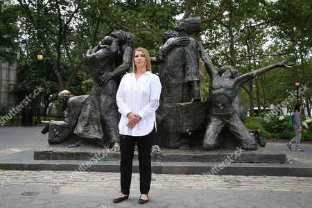 "Stock Image of CARE's COO Heather Higginbottom stands by ""The Immigrants"" statue in Battery Park on in New York, in advance of World Refugee Day showing that America stands with the 65+ Million refugees worldwide"