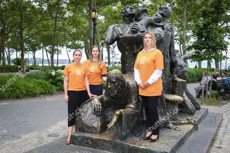 "Stock Photo of CARE's COO Heather Higginbottom and team stand by ""The Immigrants"" statue in Battery Park on in New York, in advance of World Refugee Day showing that America stands with the 65+ Million refugees worldwide"