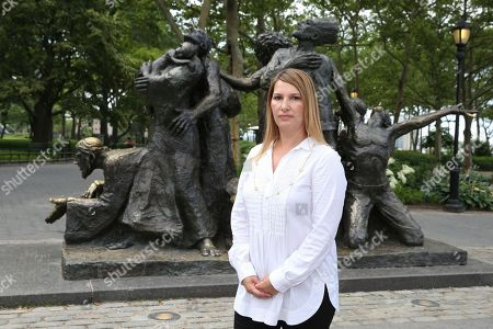 """CARE's COO Heather Higginbottom stands by """"The Immigrants"""" statue in Battery Park on in New York, in advance of World Refugee Day showing that America stands with the 65+ Million refugees worldwide"""