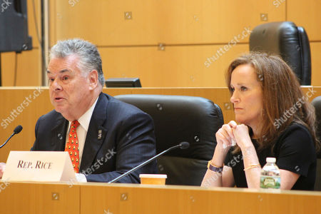 Rep. Peter King, left, and Rep. Kathleen Rice, listen to testimony of the House Subcommittee on Terrorism and Intelligence at a hearing on Tuesday, June, 20, 2017, at the U.S. District Courthouse in Central Islip, N.Y. The hearing focused on gang violence, particularly the MS-13 street gang which has been blamed for 19 killings on Long Island in the past 18 months