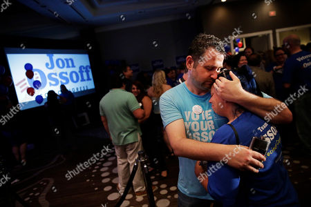 Stock Image of Matthew Levy, Sheila Levy Matthew Levy, left, comforts his wife Sheila Levy after Democratic candidate for 6th congressional district Jon Ossoff conceded to Republican Karen Handel at his election night party in Atlanta