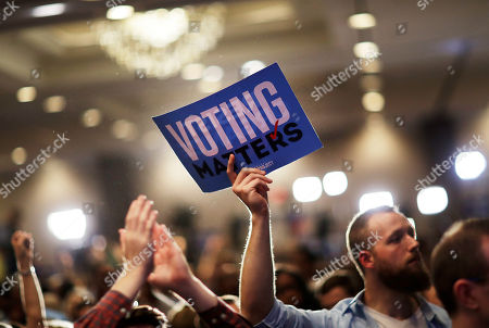 A supporter holds up a sign while attending the election night party of Democratic candidate for 6th congressional district Jon Ossoff in Atlanta