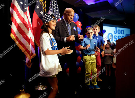 Rep. John Lewis, D-Ga., second from left, dances onstage with children before speaking at an election night party for Democratic candidate for 6th congressional district Jon Ossoff in Atlanta