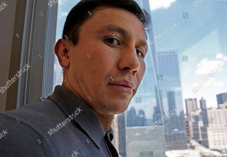 "IBF and WBC middleweight boxing champion Gennady Golovkin poses for a photograph during an interview at The Associated Press, in New York. The undefeated ""Triple G"" (37-0, 33 knockouts) puts his middleweight belts on the line against Saul ""Canelo"" Alvarez (49-1-1, 34 KOs), Sept. 16th in a highly anticipated superfight"