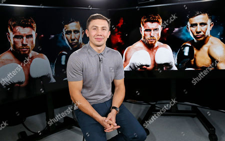 "IBF and WBC world middleweight boxing champion Gennady Golovkin poses beside giant photographs of himself and upcoming opponent, eight-time title holder Saul ""Canelo"" Alvarez, pictured, far left and second right, during an interview, at The Associated Press in New York in advance of their Sept. 16th Las Vegas ""super fight"