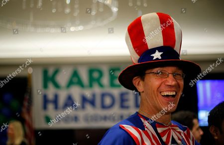 Peter Ludwinski of Sandy Springs, Ga., laughs as he waits for an election-night watch party to begin for Republican candidate for Georgia's Sixth District Congressional seat Karen Handel, in Atlanta. Handel is in a hotly contested runoff with Democrat Jon Ossoff