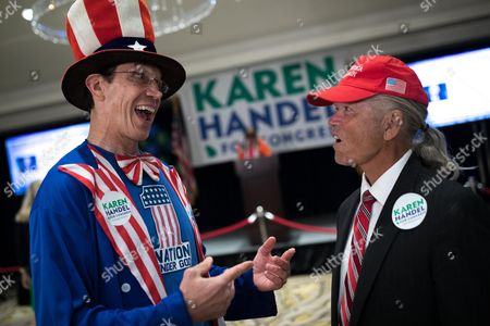 Peter Ludwinski (L) and Joe Webb (R) talk during an election party for US House of Representatives candidate Karen Handel in Atlanta, Georgia, USA, 20 June 2017. Handel faces Democrat Jon Ossoff in the expensive and closely watched special runoff election to fill Georgia's 6th Congressional District seat previously held by Health and Human Services Secretary Tom Price, a Republican.