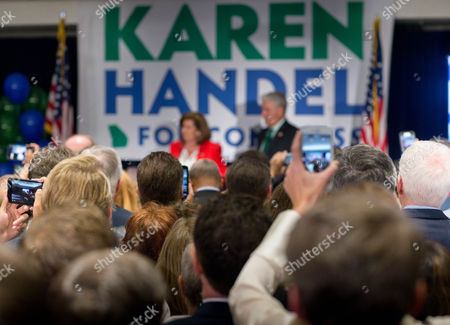 Supporters listen as US House of Representatives candidate Karen Handel delivers a victory speech after defeating Democrat Jon Ossoff during an election party in Atlanta, Georgia, USA, 20 June 2017.