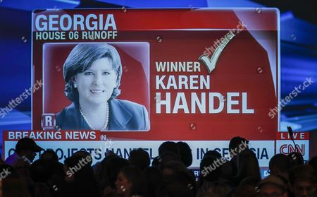 Supporters of Democratic US House of Representatives candidate Jon Ossoff watch a large-screen television as his opponent, Republican Karen Handel, is projected as the winner by CNN, during an election night party in Atlanta, Georgia, USA, 20 June 2017. Ossoff faced Republican Karen Handel in the expensive and closely watched special runoff election to fill Georgia's 6th Congressional District seat previously held by Health and Human Services Secretary Tom Price, a Republican.