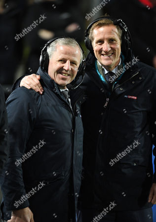 Sean Fitzpatrick (ex - All Black captain) and Will Greenwood (ex - England & Lions centre) - smile for the camera before a live pre-match broadcast for Sky television.