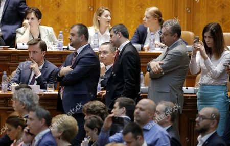 Stock Image of Ruling coalition lawmakers wait for the final result as they watch the no-confidence vote procedures, at Parlament Palace in Bucharest, Romania, 21 June 2017. Grindeanu cabinet was ousted by a no-confidence vote in which 241 lawmakers from a total of 251 voted against the government. The ruling party PSD (Social Democracy Party) withdrew political support for Grindeanu governemnt on June 14, after six months activity. PSD leader Liviu Dragnea stated that Sorin Grindeanu and his team had failed to respect the party's governing program, and did not have the party support anymore. Grindeanu defended his cabinet announcing he will not resign if PSD party leader Liviu Dragnea did not resign as well. PSD rushed on Sunday June 18 to trigger a no-confidence vote in Parliament against Grindeanu cabinet. Dranea must propose a new premier on behalf or ruling coalition next days.