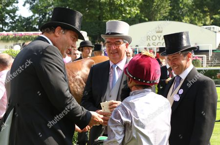 Gregory Benoist with Harry Herbert (left) after Qemah wins Prince William Stakes (Group 2) at Royal Ascot