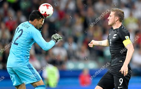 Mexico goalkeeper Alfredo Talavera heads the ball as New Zealand's Chris Wood looks at him, during the Confederations Cup, Group A soccer match between Mexico and New Zealand, at the Fisht Stadium in Sochi, Russia