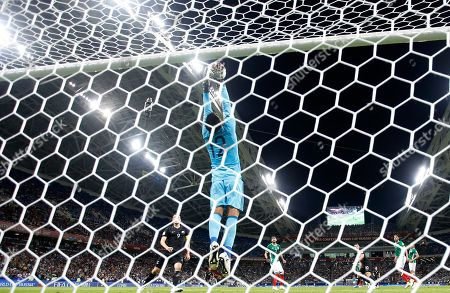 Mexico goalkeeper Alfredo Talavera saves during the Confederations Cup, Group A soccer match between Mexico and New Zealand, at the Fisht Stadium in Sochi, Russia