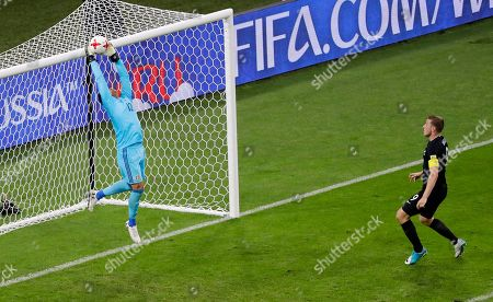 Mexico goalkeeper Alfredo Talavera, left, saves as New Zealand's Chris Wood looks him during the Confederations Cup, Group A soccer match between Mexico and New Zealand, at the Fisht Stadium in Sochi, Russia