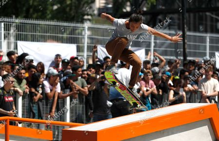 """A Mexican skateboarder performs a trick at the annual """"Go Skateboarding Day"""" event in Mexico City, . Skateboarders around the world gather on June 21 to celebrate and promote skateboarding. Mexico City celebrated the day by inaugurating a skatepark in the city's historic center. Participants were treated to a demo by special guest Brazilian skateboarder Leticia Bufoni"""