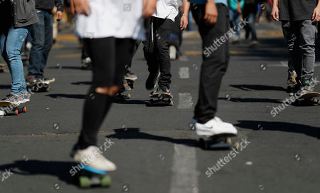 """Mexican skateboarders ride to the new skatepark hosting the annual """"Go Skateboarding Day"""" event in Mexico City, . Skateboarders around the world gather on June 21 to celebrate and promote skateboarding. Mexico City celebrated the day by inaugurating a skatepark in the city's historic center. Participants were treated to a demo by special guest Brazilian skateboarder Leticia Bufoni"""