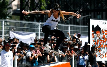 """Brazilian skateboarder Leticia Bufoni performs a trick at the annual """"Go Skateboarding Day"""" event in Mexico City, . Skateboarders around the world gather on June 21 to celebrate and promote skateboarding. Mexico City celebrated the day by inaugurating a skatepark in the city's historic center"""