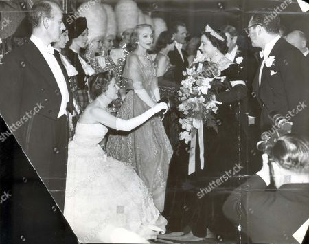 Queen Elizabeth (queen Mother) (died 30/3/02) 30 October 1950 The Royal Family At The Royal Film Performance Of ' The Mudlark ' At The Empire Theatre Leicester Square London. Actress Irene Dunne Who Played Queen Victoria In The Mudlark Curtsies To The Queen At The Royal Film Performance. Marlene Dietrich Waits To Be Presented....royalty
