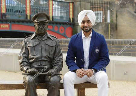 Stock Image of Satinder Sartaaj sits with the statue of Dads Army character Captain Mainwaring