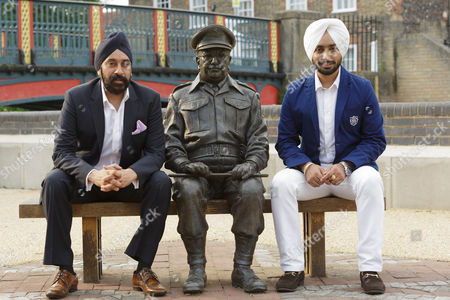 Satinder Sartaaj, sits with the statue of Dads Army character Captain Mainwaring and historian and writer Peter Bance, left