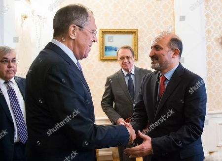 Stock Image of Sergey Lavrov, Ahmad Jarba Russian Foreign Minister Sergey Lavrov, left, greets Ahmad Jarba, the head of the opposition Syria Tomorrow Movement in Moscow, Russia, . Jarba hailed Russia's role in efforts to settle the Syrian conflict