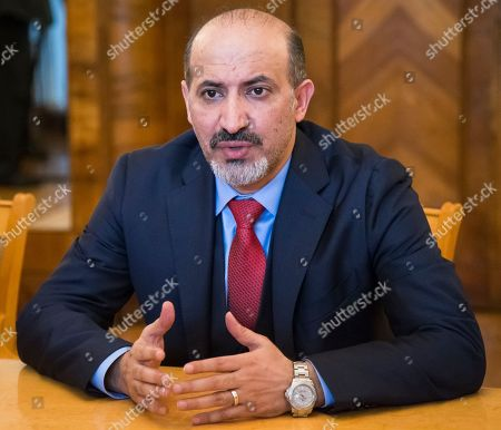 Stock Picture of Ahmad Jarba, the head of the opposition Syria Tomorrow Movement speaks to Russian Foreign Minister Sergey Lavrov during their talks in Moscow, Russia, . Jarba hailed Russia's role in efforts to settle the Syrian conflict