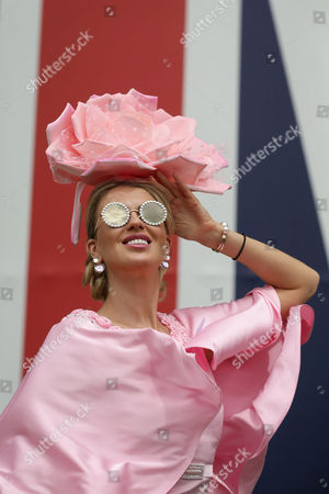 Natalia Kapchuk poses for pictures  in a hat by Artur Rios as she arrives on Ladies Day at Royal Ascot near London, Britain, 22 June 2017. Royal Ascot runs until 24 June.