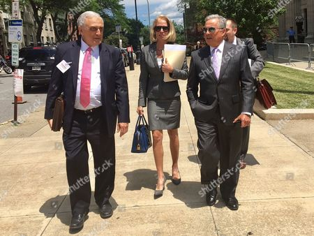 Stock Picture of Carl Paladino, left, walks with his his lawyers Jennifer Persico and Dennis Vacco outside education building during break in a hearing on in Albany, N.Y. Several days of hearings are scheduled in Albany for wealthy developer Carl Paladino to determine whether his public release of information on teacher contract talks should cost him his position on the Buffalo School Board