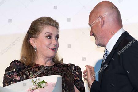 Catherine Deneuve and UniFrance president Jean Paul Salome