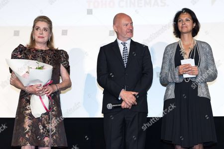 Catherine Deneuve, UniFrance president Jean Paul Salome and UniFrance general director Isabelle Giordano