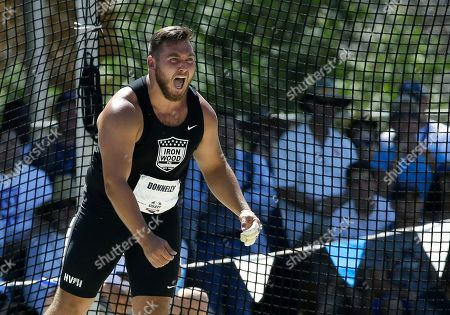 Sean Donnelly reacts after an effort in the men's hammer throw at the U.S. Track and Field Championships, in Sacramento, Calif. Donnelly placed third in the event