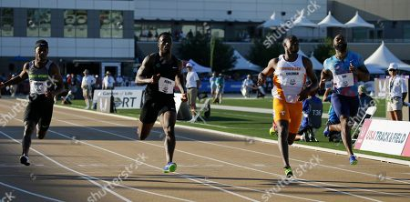 Tyson Gay, right, races against Christian Coleman, second from right, Jeff Demps, second from left, and LeShon Collins, left, in a heat of the first round of the men's 100 meters at the U.S. Track and Field Championships, in Sacramento, Calif. Gay just missed qualifying for the next round, but Coleman finished first. Gay has been running with a heavy heart since his 15-year-old daughter was shot and killed in October 2016 outside a restaurant in Kentucky
