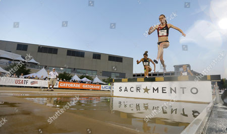 Courtney Frerichs, right, and Stephanie Garcia, left, approach the water in a heat of the first round of the women's 3,000-meter steeplechase at the U.S. Track and Field Championships, in Sacramento, Calif