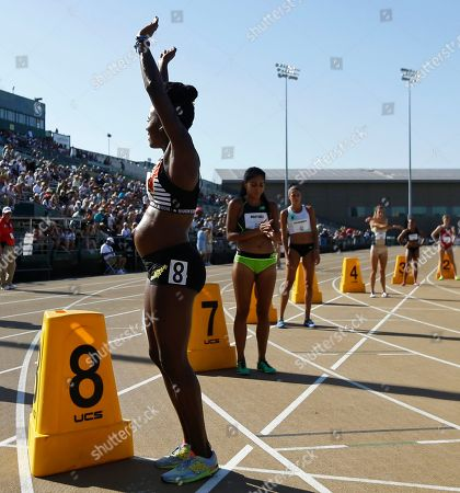 Alysia Montano (8), who is five months pregnant, waves to the crowd before the start of a heat in the 1st round of the women's 800 meters at the U.S. Track and Field Championships, in Sacramento, Calif