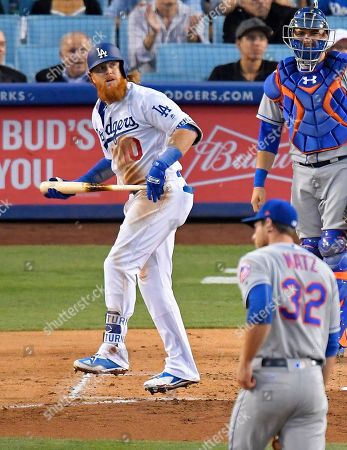 Justin Turner, Steven Matz, Travis d'Arnaud Los Angeles Dodgers' Justin Turner watches his solo home run off New York Mets starting pitcher Steven Matz, lower right, during the third inning of a baseball game, in Los Angeles