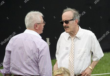 United States Senator Eliot Engel (Democrat of New York), left, with an unidentified person, right, on the South Lawn of the White House in Washington, DC prior to the arrival of US President Donald J. Trump and first lady Melania Trump for the annual Congressional Picnic on the South Lawn