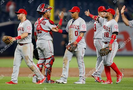 Cliff Pennington, Martn Maldonado, Yunel Escobar, David Hernandez, Luis Valbuena Members of the Los Angeles Angels celebrate after a baseball game against the New York Yankees in New York, . The Angels defeated the Yankees 10-5. From left, Angels second baseman Cliff Pennington (7), catcher Maritn Maldonado, third baseman Yunel Escobar (0), relief pitcher David Hernandez, and Luis Valbuena