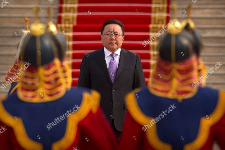 In this July 17, 2016 photo, Mongolia's President Tsakhiagiin Elbegdorj inspects an honor guard before a welcome ceremony for South Korea's President Park Geun-hye in Ulaanbaatar, Mongolia. Mongolians will vote for a new president on in a race pitting a horse salesman against a former judo star and a nationalist wanting to preserve the vast landlocked country's mineral wealth