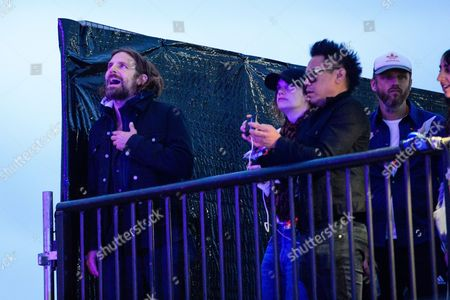 Bradley Cooper, Ruth Wilson and Alasdhair Willis watch Radiohead perform on The Pyramid Stage