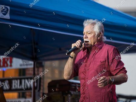 Joe Bonsall of the Oak Ridge Boys performs on Main Street to a crowd of 8,000 fans