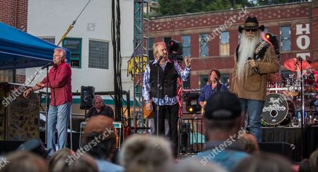 Joe Bonsall, Duane Allen, and William Lee Golden of the Oak Ridge Boys performs on Main Street to a crowd of 8,000 fans
