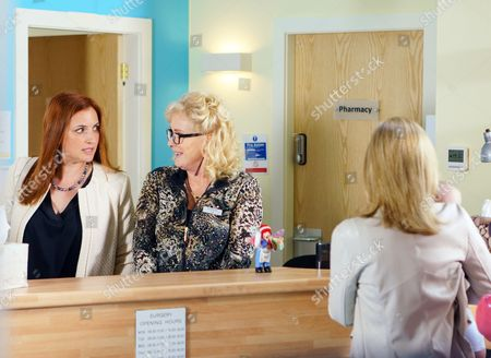 Moira Pollack, as played by Louisa Patikas, heads out to a meeting leaving Liz McDonald, as played by Beverley Callard, in charge of reception. As the queue of patients buckles and the phone continually rings, Liz struggles to keep her temper. How will battleaxe Moira react? (Ep 9207 - Fri 14 July 2017).