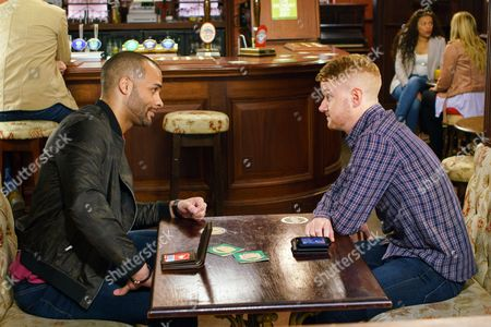 Stock Picture of Joe, as played by Chord Melodic, tells Gary Windass, as played by Mikey North, he's running his own private security firm in the Ukraine, the money is fantastic and he should consider coming to work for him. How will Gary react? (Ep 9208 - Fri 14 July 2017).